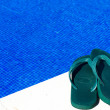 Flip-flops by the swimming pool — Stock Photo