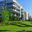 Apartment houses and green grass — Stock Photo #31394073