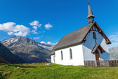 Small white church in the alps — Stock Photo