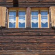Two windows of a wooden hut — Stock Photo