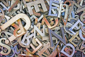 Pile of different iron letters — Stock Photo