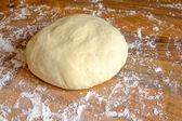 Ball of homemade pizza dough — Stock Photo