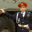 Stock Photo: Young cadet with armoured troop carrier
