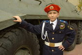 Young cadet with an armoured troop carrier — Stock Photo