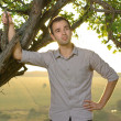 Guy under tree on field — Stock Photo #30546659