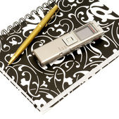 Dictaphone, notepad and ballpen on white — Stock Photo