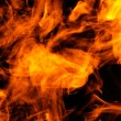 Stock Photo: Fire on a black background