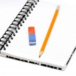 Notebook, pencil, eraser — Stock Photo #24580085