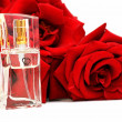 Perfume and roses — Stock Photo