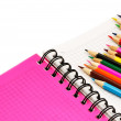 Color pencils and pocket-book — Stock Photo #32323907