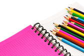 Color pencils and pocket-book — Stock Photo