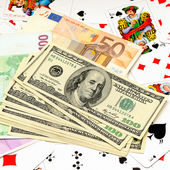 Money and playing cards — Stock Photo