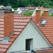 Tile roof with a chimney — Stock Photo #41483327