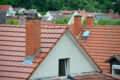 Tile roof with a chimney — Stock Photo