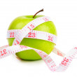Green apple and measure tape — Stock Photo