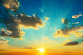 Clouds illuminated by sunlight. Sunset. — Stock Photo