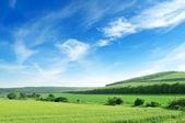 Mountainous terrain and the blue sky — Stock Photo