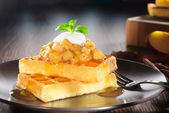 Waffles with apple topping — Stock Photo