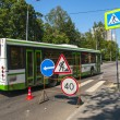 Bus travels around road works — Stock Photo #15596333
