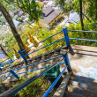 Stairs leading to the mountain in a Buddhist monastery in Thailand — Stock Photo