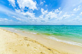 Tropical island. The beach with white sand and rocks in Thailand — Stock Photo