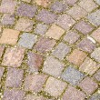 Outdoor tiles, cobblestones and storm drain on the street the Italian city — Stock Photo