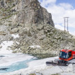 Stock Photo: Tractor cleaning snow on ski slopes in Alps