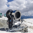 Snow cannon on the slopes at the top of the Alps in the snow — Stock Photo