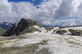 Melting glaciers and rocks on a mountain top at an altitude of 2400 meters in the Italian Alps — Stock Photo