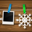 Stock vektor: Blank photo frames and snowflakes on a clothesline