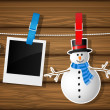 Blank photo frames, snowman and Santa on a clothesline — Stock Vector