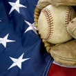 Major league baseball with American flag and glove — Stock Photo #14583873