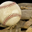 Stock Photo: Baseball ball on glove with black background