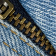 Closeup of zipper in blue jeans — Stock fotografie