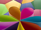 Colored paper background shaped like flower — Stock Photo