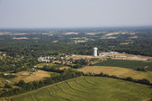 Aerial view of farm fields and trees — ストック写真