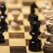 Chess pieces on a chess board table — Stock Photo