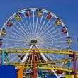 Attraction is the wheel of review on background blue sky - Stock Photo