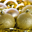 Golden christmas ball ornaments — Stock Photo