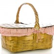 Classic picnic basket with a red gingham liner on a white background — Stock Photo #14766257