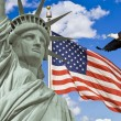 图库照片: AmericFlag, flying bald Eagle,statue of liberty montage