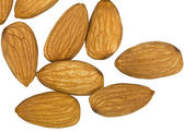 Almonds in small group is isolated on a white background — Stok fotoğraf