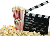 Movie Clapper Board in popcorn with film reel isolated on white — 图库照片