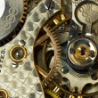 Stock Photo: Macro of gears and works of antique pocket watch