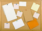 Cork bulletin board with notes — Stock Photo