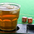 Stock Photo: Drink on craps table