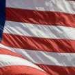American Flag waving in the wind — Stok fotoğraf