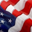 Stockfoto: AmericFlag waving in wind