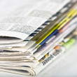 Closeup of stack of newspapers — Stock Photo
