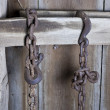 Rusty chain hanging in barn — Stock Photo